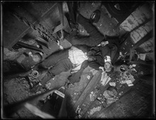 In this Nov 24, 1915 photo provided by the New York City Municipal Archives, the bodies of elevator operator Robert Green, left and Jacob Jagendorf, a building engineer, lie at the bottom of an elevator shaft in New York. Over 870,000 photos from an archive that exceeds 2.2 million images have been scanned and made available online, for the first time giving a global audience a view of a rich collection that documents life and sometimes death in New York City. (AP Photo/New York City Municipal Archives, NYPD Evidence Collection)
