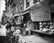 In this July 29, 1908 photo provided by the New York City Municipal Archives, workers dig in the street along the sidewalk on the north side of Delancey Street in New York. Over 870,000 photos from an archive that exceeds 2.2 million images have been scanned and made available online, for the first time giving a global audience a view of this rich collection that documents New York City life.  (AP Photo/New York City Municipal Archives, Department of Bridges/Plant & Structures,  Eugene de Salignac)