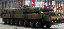 In this photo taken Sunday, April 15, 2012, what appears to be a new missile is carried during a military parade at the Kim Il Sung Square in Pyongyang, North Korea, to celebrate the 100th anniversary of the country's founding father. The photo shows the warhead's surface is undulated, suggesting it's a thin metal sheet unable to withstand flight pressure. Analysts say the half dozen missiles showcased at the military parade were low-quality fakes. (AP Photo/Ng Han Guan)