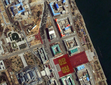 This April 15, 2012 satellite image provided by DigitalGlobe shows a parade held to mark the 100th anniversary of Kim Il-sung's birthday Pyongyang, North Korea. The parade can be seen from the top center of the frame as it makes it way toward Kim Il Sung Square in the lower right hand corner where a large formation of people in red and gold clothing spell out in Korean the characters for the word