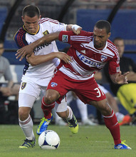 Real Salt Lake Luis Gil, left, and FC Dallas Scott Seally (31) vie for control of the ball during the first half of an MLS soccer game on Wednesday, April 25, 2012, in Frisco, Texas. (AP Photo/LM Otero)