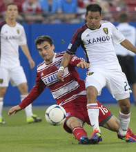 Real Salt Lake Paulo Junior (23) and FC Dallas Bobby Warshaw (16) battle for the ball during the first half of an MLS soccer game on Wednesday, April 25, 2012, in Frisco, Texas. (AP Photo/LM Otero)