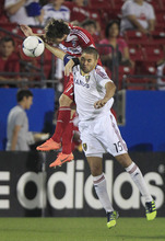 Real Salt Lake Alvaro Saborio (15) and FC Dallas Zach Loyd jump for a header during the second half of an MLS soccer game on Wednesday, April 25, 2012, in Frisco, Texas. The teams played to a 1-1 tie.  (AP Photo/LM Otero)