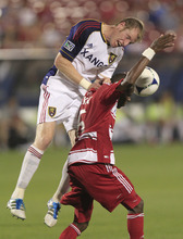 Real Salt Lake Nat Borchers, left, and FC Dallas Jackson (6) vie fora header during the second half of an MLS soccer game on Wednesday, April 25, 2012, in Frisco, Texas. The teams played to a 1-1 tie. (AP Photo/LM Otero)