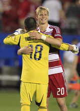 FC Dallas' Brek Shea (20) and Real Salt Lake goalie Nick Rimando (18) hug after their teams played to a 1-1 tie in an MLS soccer game on Wednesday, April 25, 2012, in Frisco, Texas. (AP Photo/LM Otero)