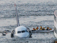 FILE - In this Jan. 15, 2009 file photo, passengers in an inflatable raft move away from an Airbus 320 US Airways aircraft that has gone down in the Hudson River in New York. The day after geese hit a second airliner and forced it to make an emergency landing at a New York airport, U.S. Sen. Kirsten Gillibrand, D-NY, introduced legislation Wednesday, April 25, 2012 that would make it easier to round up geese near JFK Airport and kill them.  (AP Photo/Bebeto Matthews, File)