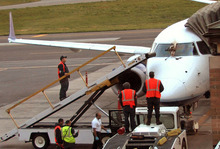 FILE- In this April 24, 2012 file photo, emergency responders and aircraft mechanics survey the damage to a JetBlue plane that made an emergency landing at the Westchester County Airport in Purchase, N.Y., after a bird strike. The day after geese hit the airliner and forced it to make an emergency landing, U.S. Sen. Kirsten Gillibrand, D-NY, introduced legislation Wednesday, April 25, 2012 that would make it easier to round up geese near JFK Airport and kill them.  (AP Photo/The Journal News, Matthew Brown)  NYC METRO OUT; TV OUT; MAGS OUT; NO SALES