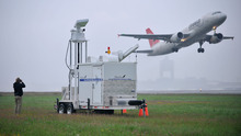 FILE- In this July 7, 2009 file photo, Andreas Smith, project manager for DeTect, Inc., of Panama City, Fla., watches for birds flying near an active runway at Logan International Airport in Boston. Smith was part of the team calibrating a radar unit designed to help avoid aircraft bird strikes at the airport. Although there is evidence that bird-control efforts near airports are paying off, U.S. Sen. Kirsten Gillibrand, D-NY, introduced legislation on Wednesday, April 25, 2012 that would make it easier to round up geese near JFK Airport and kill them, after a second airliner was forced from the skies over New York due to a bird strike. (AP Photo/Josh Reynolds, File)