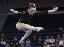 Utah's Stephanie McAllister competes on the balance beam during the finals of the NCAA women's gymnastics championships  Saturday, April 21 2012 in Duluth, Ga., . (AP Photo/John Bazemore)