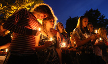 Steven Belgeri, left, and his girlfriend, Taylor Scott, console each other Wednesday April 25, 2012 at Southern Illinois University in Edwardsville, Ill., A candlelight vigil held on the quad at Southern Illinois University in Edwardsville, Ill., for SIU students Lacy V. Saddall and Lauren D. Petersen. The best friends died Monday in a St. Louis hospital from injuries they received in a fire at their upstairs apartment in the 600 block of Hillsboro Street in Edwardsville early Sunday. (AP Photo/The Telegraph, John Badman)  THE NEWS-DEMOCRAT AND THE POST-DISPATCH OUT