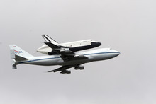 Space shuttle Enterprise, riding on the back of the NASA 747 Shuttle Carrier Aircraft, cruises over the Hudson river,  Friday, April 27, 2012 in New York. Enterprise is eventually going to make its new home in New York City at the Intrepid Sea, Air and Space Museum.(AP Photo/Mary Altaffer)