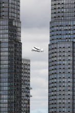Space shuttleEnterprise, riding on the back of the NASA 747 Shuttle Carrier Aircraft, cruises over the Hudson river,  Friday, April 27, 2012 in New York. Enterprise is eventually going to make its new home in New York City at the Intrepid Sea, Air and Space Museum.  (AP Photo/Mary Altaffer)