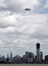 Space shuttle Enterprise, riding on the back of the NASA 747 Shuttle Carrier Aircraft, arrives in New York, Friday, April 27, 2012. Enterprise is eventually going to make its new home in New York City at the Intrepid Sea, Air and Space Museum. (AP Photo/Mark Lennihan)