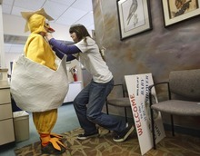Leah Hogsten  |  The Salt Lake Tribune John Adams, 12, gets help from Jessi Adams, 16, while donning a chicken costume to advertise and welcome visitors to the Wildlife Rehabilitation Center of Northern Utah on Friday in Ogden. The center is hosting its 3rd Annual Wildlife Baby Shower/Open House fundraiser this weekend. The event continues 11 a.m. to 5 p.m. Saturday and Sunday.