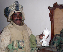 This Nov. 2004 photo provided by Garrett Anderson shows U.S. Marine Lance Cpl. Jermaine Coburn holding a shell-shocked bird during operations in Fallujah, Iraq. Anderson, an ex-Marine filmmaker whose unit carried pocket digital cameras into some of the worst fighting in Iraq is using that footage, and post-war interviews, to open viewers' eyes about combat and help himself deal with the lasting emotional impact. (AP Photo/Garrett Anderson)