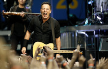 Musician Bruce Springsteen performs with the E Street Band during a concert in Los Angeles, Thursday, April 26, 2012.  (AP Photo/Matt Sayles)