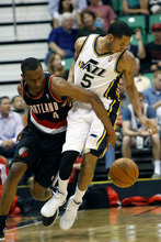 Chris Detrick  |  The Salt Lake Tribune Utah Jazz point guard Devin Harris (5) and Portland Trail Blazers guard Nolan Smith (4) go for the ball during the first quarter of the game at EnergySolutions Arena Thursday April 26, 2012. The Jazz are winning the game 23-16.