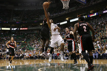 Chris Detrick  |  The Salt Lake Tribune Utah Jazz point guard Devin Harris (5) shoots past Portland Trail Blazers power forward J.J. Hickson (21) during the first quarter of the game at EnergySolutions Arena Thursday April 26, 2012. The Jazz are winning the game 23-16.