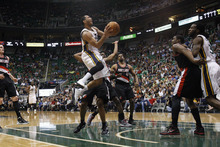 Chris Detrick  |  The Salt Lake Tribune Utah Jazz point guard Devin Harris (5) shoots the ball during the first quarter of the game at EnergySolutions Arena Thursday April 26, 2012. The Jazz are winning the game 23-16.