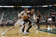 Chris Detrick  |  The Salt Lake Tribune Utah Jazz shooting guard Gordon Hayward (20) runs past Portland Trail Blazers small forward Luke Babbitt (8) during the first quarter of the game at EnergySolutions Arena Thursday April 26, 2012. The Jazz are winning the game 23-16.