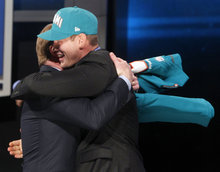 Texas A&M quarterback Ryan Tannehill, right, hugs NFL Commissioner Roger Goodell after being selected as the eighth pick overall by the Miami Dolphins in the first round of the NFL football draft at Radio City Music Hall, Thursday, April 26, 2012, in New York. (AP Photo/Jason DeCrow)
