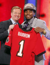 Alabama's Mark Barron, right, poses for photographs with NFL Commissioner Roger Goodell after being selected as the seventh pick overall by the Tampa Bay Buccaneers in the first round of the NFL football draft at Radio City Music Hall, Thursday, April 26, 2012, in New York. (AP Photo/Jason DeCrow)