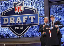 Boise State defensive end Shea McClellin, right, poses for photographs with NFL Commissioner Roger Goodell after being selected 19th overall by the Chicago Bears in the first round of the NFL football draft at Radio City Music Hall, Thursday, April 26, 2012, in New York. (AP Photo/Jason DeCrow)