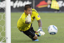 Real Salt Lake goal keeper Nick Rimando leaps to block a shot on goal in the first half of an MLS soccer match against FC Dallas Saturday, July 17, 2010 in Frisco, Texas. (AP Photo/Tony Gutierrez)
