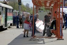 People assist injured after explosion in Dnipropetrovsk, Ukraine, Friday, April 27, 2012.  Ukraine officials say dozens of people including schoolchildren were injured in four blasts in eastern city. (AP Photo/Dmitriy Dvorsky)