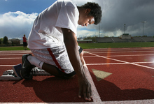 Steve Griffin/The Salt Lake Tribune   Sprinter Jarvis Andrews has been dominant in the 100-meter dash this season, and is Kearns High School's best shot at a state title. He is photographed here on the school's track in Kearns, Utah Monday April 23, 2012.