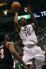Chris Detrick  |  The Salt Lake Tribune Utah Jazz forward/center Derrick Favors (15) shoots past Portland Trail Blazers power forward Craig Smith (83) during the first quarter of the game at EnergySolutions Arena Thursday April 26, 2012. The Jazz are winning the game 23-16.