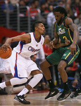 Los Angeles Clippers' guard Nick Young , left, drives against Utah Jazz's forward DeMarre Carroll during the first half of a NBA basketball game in Los Angeles, Saturday, March 31, 2012.  (AP Photo/Ringo H.W. Chiu)