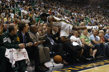 Chris Detrick  |  The Salt Lake Tribune Utah Jazz forward DeMarre Carroll (3) falls into the Jazz bench during the first quarter of the game at EnergySolutions Arena Thursday April 26, 2012. The Jazz are winning the game 23-16.
