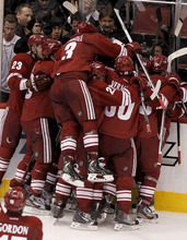 Phoenix Coyotes' Keith Yandle (3) leaps into the celebration as Oliver Ekman-Larsson (23), of Sweden, Daymond Langkow (22), Antoine Vermette (50), Adrian Aucoin (33) and Radim Vrbata (17), of the Czech Republic, surround Ray Whitney after his game-winning goal against the Nashville Predators during overtime of Game 1 in an NHL hockey Stanley Cup Western Conference semifinal playoff series, Friday, April 27, 2012, in Glendale, Ariz. The Coyotes won 4-3. (AP Photo/Ross D. Franklin)