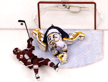 As he tries to get a shot on goal, Phoenix Coyotes' Lauri Korpikoski (28), of Finland, gets tripped up by Nashville Predators goalie Pekka Rinne (35), of Finland, during the first period of Game 1 in an NHL hockey Stanley Cup Western Conference semifinal playoff series, Friday, April 27, 2012, in Glendale, Ariz. The Coyotes won 4-3 in overtime. (AP Photo/Ross D. Franklin)