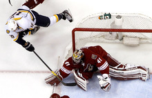 Phoenix Coyotes goalie Mike Smith (41) makes a save on a shot from a diving Nashville Predators' Brandon Yip (18) during the second period of Game 1 in an NHL hockey Stanley Cup Western Conference semifinal playoff series, Friday, April 27, 2012, in Glendale, Ariz. The Coyotes won 4-3. (AP Photo/Ross D. Franklin)