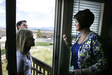 Scott Sommerdorf  |  The Salt Lake Tribune              Realtor Donna Pozzuoli, right, shows Chace and Madison Larsen a property in Herriman, Sunday April 22, 2012. The Larsens are buying this home at a time when the market is slowly improving.
