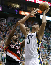 Portland Trail Blazers forward Craig Smith and Utah Jazz forward Enes Kanter (0) battle for a rebound during the first half of an NBA basketball game, Thursday, April 26, 2012, in Salt Lake City. (AP Photo/Jim Urquhart)