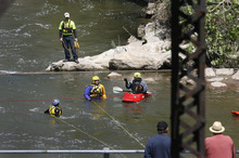 Scott Sommerdorf  |  The Salt Lake Tribune              Search and rescue personnel search for a missing 3-year-old boy in the Weber River just north of Exchange Road in Ogden, Sunday, April 29, 2012.