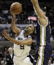Eric Gay  |  The Associated Press San Antonio Spurs' Tony Parker (9), of France, is defended by Utah Jazz's Enes Kanter, right, during the fourth quarter of Game 1 of a first-round NBA basketball playoff series,Sunday in San Antonio.  San Antonio won 106-91.(