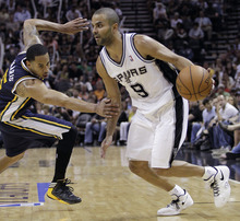 Eric Gay  |  The Associated Press San Antonio Spurs' Tony Parker (9), of France, is defended by Utah Jazz's Devin Harris, left, during the third quarter of Game 1 of a first-round NBA basketball playoff series on Sunday in San Antonio. San Antonio won 106-91.
