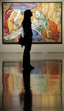 A visitor stands in front of Heinrich Nauen's 'Lamentation of Christ' painting during the exhibition of 'El Greco and the Modernism' at the Museum Kunstpalast  in Duesseldorf, Germany, Thursday, April 26, 2012. The exhibition runs from April 28, 2012 until August 12, 2012.(AP Photo/Frank Augstein)