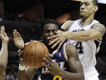 Utah Jazz's DeMarre Carroll, left, is defended by San Antonio Spurs' Danny Green, right, during the first quarter of Game 1 of a first-round NBA basketball playoff series on Sunday, April 29, 2012, in San Antonio. (AP Photo/Eric Gay)
