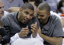 San Antonio Spurs' Tony Parker, right, of France, jokes with teammate Tim Duncan during the fourth quarter of Game 1 of a first-round NBA basketball playoff series against the Utah Jazz, Sunday, April 29, 2012, in San Antonio. San Antonio won 106-91. (AP Photo/Eric Gay)