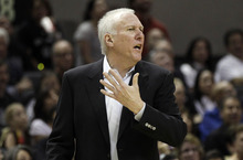 San Antonio Spurs head coach Gregg Popovich argues a call during the fourth quarter of Game 1 of a first-round NBA basketball playoff series against the Utah Jazz, Sunday, April 29, 2012, in San Antonio. San Antonio won 106-91.(AP Photo/Eric Gay)