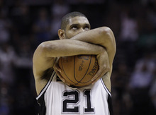 San Antonio Spurs' Tim Duncan clutches the ball prior to the first quarter of Game 1 of a first-round NBA basketball playoff series against the Utah Jazz, Sunday, April 29, 2012, in San Antonio. (AP Photo/Eric Gay)