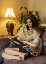 Trent Nelson  |  The Salt Lake Tribune Jack Wolfinger reads with his mother, Lacey, Thursday, April 26, 2012 in Ogden, Utah. After the CDC released new data on autism a few weeks ago, some experts are questioning the results. Jack was repeatedly labeled by teachers as possibly autistic, but last year a Utah psychologist said the symptoms were there but the diagnosis did not entirely fit.