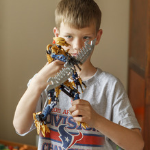 Trent Nelson  |  The Salt Lake Tribune Jack Wolfinger poses with one of his favorite toys, a Bioncle figure that he assembled, Thursday, April 26, 2012 in Ogden, Utah. After the CDC released new data on autism a few weeks ago, some experts are questioning the results. Jack was repeatedly labeled by teachers as possibly autistic, but last year a Utah psychologist said the symptoms were there but the diagnosis did not entirely fit.