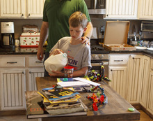 Trent Nelson  |  The Salt Lake Tribune Jack Wolfinger preparing for dinner with his father, John, in Ogden, Utah. After the CDC released new data on autism a few weeks ago, some experts are questioning the results. Jack was repeatedly labeled by teachers as possibly autistic, but last year a Utah psychologist said the symptoms were there but the diagnosis did not entirely fit.