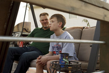 Trent Nelson  |  The Salt Lake Tribune Jack Wolfinger with his father, John, Thursday in Ogden, Utah. After the CDC released new data on autism a few weeks ago, some experts are questioning the results. Jack was repeatedly labeled by teachers as possibly autistic, but last year a Utah psychologist said the symptoms were there but the diagnosis did not entirely fit.